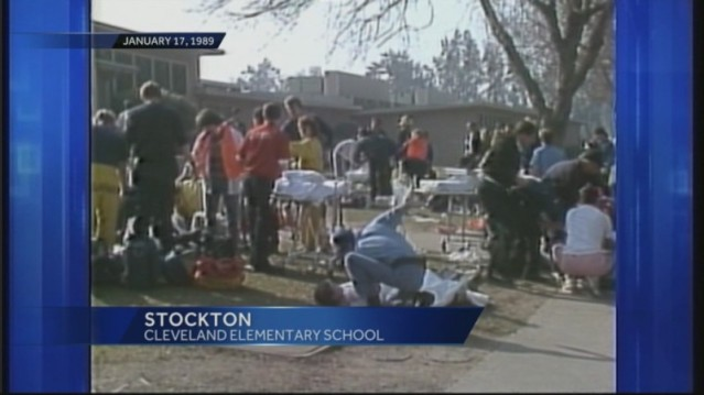 Emergency personnel assist survivors of the nation's first mass shooting of schoolchildren.