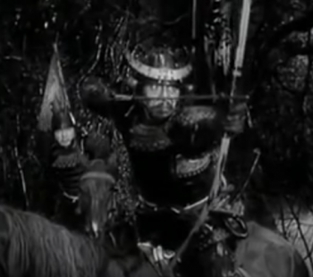 He thinks better of shooting when he hears the witches' predictions. (Screenshot, Throne of Blood official trailer)