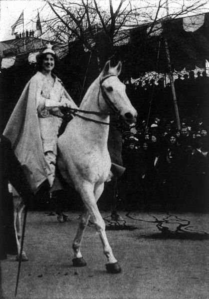 Wearing a cape and crown, suffragist activist Inez Milholland Boissevain led the 1913 women's suffrage parade in Washington on a white horse. (Library of Congress Prints and Photographs Division)