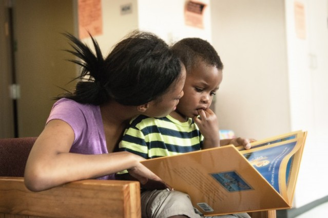 A client from the STEPS transitional living program of Chicago's Night Ministry with her son. The program is for homeless youth ages 18 to 21 who are not wards of the state, and their children. The goal is to move people into permanent housing and self-stability. (Photo courtesy of the Night Ministry)