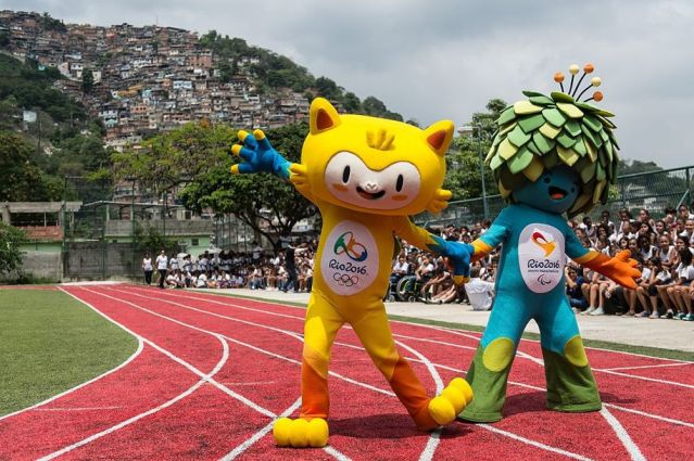 The Rio Olympics mascot, left, and the Paralympics mascot in happier times when they were presented in 2014—and before a live version of the yellow jaguar mascot was shot and killed.
