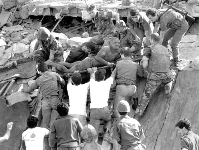 This image of a wounded Marine being rescued became a symbol of the 1983 bombing of the Marine Barracks in Beirut.