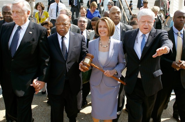 Democratic representatives march to cast the final vote for the Affordable Care Act in 2010, carrying the gavel used when Medicare was passed. Will they be this unified again?